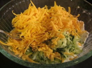 Combine the dry ingredients with the grated zucchini and cheddar.