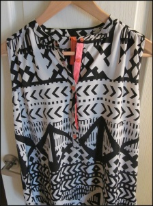Black and gray sleeveless tribal print blouse with neon pink detail from Eight Sixty